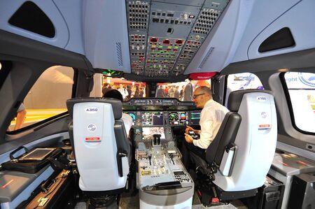 demonstrator: SINGAPORE - FEBRUARY 12: Airbus A350-900 XWB cockpit demonstrator at Singapore Airshow February 12, 2014 in Singapore Editorial