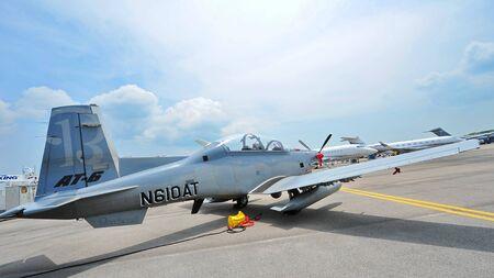 turboprop: SINGAPORE - FEBRUARY 9: Beechcraft AT-6 Texan II light attack single turboprop plane on display at Singapore Airshow February 9, 2014 in Singapore
