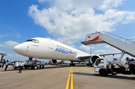 towed: SINGAPORE - FEBRUARY 12: Airbus A350-900 XWB being towed in for Singapore Airshow February 12, 2014 in Singapore Editorial