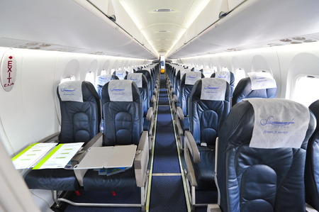turboprop: SINGAPORE - FEBRUARY 12: Interior of Bombardier Q400 nextgen turboprop plane at Singapore Airshow February 12, 2014 in Singapore