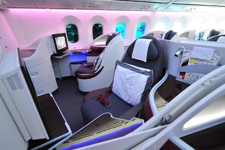 12 class: SINGAPORE - FEBRUARY 12: Luxurious business class seats onboard Qatar Airways Boeing 787-8 Dreamliner at Singapore Airshow February 12, 2014 in Singapore