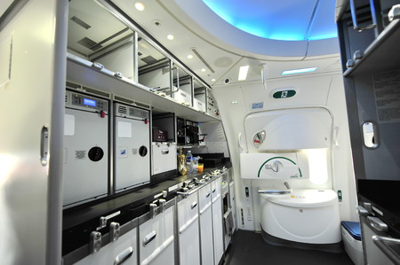 SINGAPORE - FEBRUARY 12: Front galley of Qatar Airways Boeing 787-8 Dreamliner at Singapore Airshow February 12, 2014 in Singapore Editorial