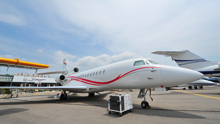twin engine: SINGAPORE - FEBRUARY 9: Dassault Falcon 7X twin engine business jet on display at Singapore Airshow February 9, 2014 in Singapore