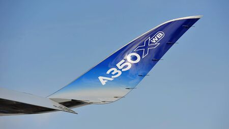 raked: SINGAPORE - FEBRUARY 12: Raked winglet of the Airbus A350-900 XWB at Singapore Airshow February 12, 2014 in Singapore