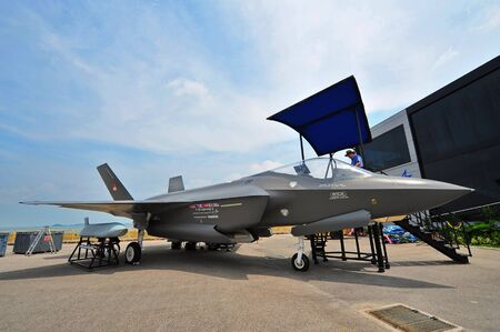trade off: SINGAPORE - FEBRUARY 9: Mock-up of Lockheed Martin F-35 Lightning joint strike fighter at Singapore Airshow February 9, 2014 in Singapore