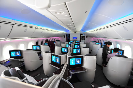 12 class: SINGAPORE - FEBRUARY 12: Spacious business class cabin of Qatar Airways Boeing 787-8 Dreamliner at Singapore Airshow February 12, 2014 in Singapore Editorial