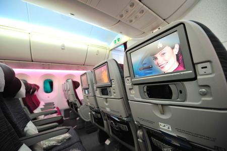 12 class: SINGAPORE - FEBRUARY 12: Qatar Airways Boeing 787-8 Dreamliner economy class cabin and inflight entertainment system (IFE) at Singapore Airshow February 12, 2014 in Singapore