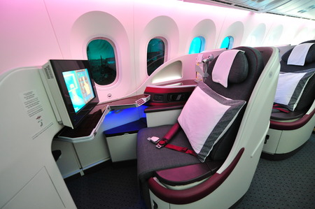 SINGAPORE - FEBRUARY 12: Luxurious and spacious business class seats in a Qatar Airways Boeing 787-8 Dreamliner at Singapore Airshow February 12, 2014 in Singapore Redakční