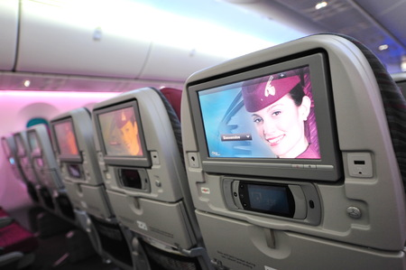 12 class: SINGAPORE - FEBRUARY 12: Spacious and comfortable economy class cabin of Qatar Airways Boeing 787-8 Dreamliner at Singapore Airshow February 12, 2014 in Singapore