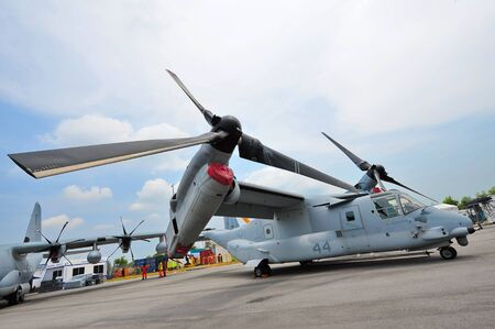SINGAPORE - FEBRUARY 9: Bell Boeing MV-22 Osprey tilt rotor aircraft with vertical take-off and landing (VTOL) capability on display at Singapore Airshow February 9, 2014 in Singapore Editorial