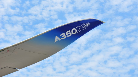 raked: SINGAPORE - FEBRUARY 12: Raked winglet of an Airbus A350-900 aircraft at Singapore Airshow February 12, 2014 in Singapore