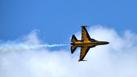 manoeuvre: SINGAPORE - FEBRUARY 16:  RKAF Black Eagles Aerobatic Team aerobatic performance at Singapore Airshow February 16, 2016 in Singapore Editorial