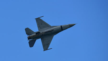 usaf: SINGAPORE - FEBRUARY 16:  USAF F-16CD Fighting Falcon performing aerial display at Singapore Airshow February 16, 2016 in Singapore Editorial