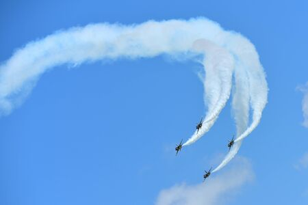 aerobatic: SINGAPORE - FEBRUARY 16:  RKAF Black Eagles Aerobatic Team aerobatic performance at Singapore Airshow February 16, 2016 in Singapore Editorial