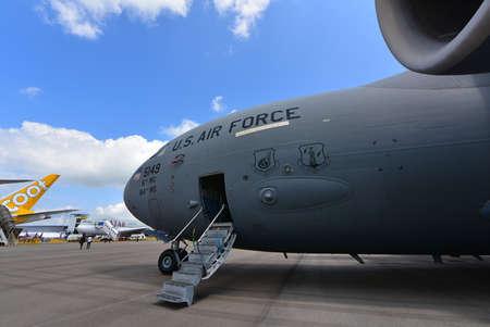 usaf: SINGAPORE - FEBRUARY 16:  USAF Boeing C-17 Globemaster III military transport aircraft on display at Singapore Airshow February 16, 2016 in Singapore