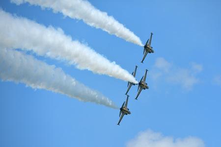 SINGAPORE - FEBRUARY 16:  RKAF Black Eagles Aerobatic Team aerobatic performance at Singapore Airshow February 16, 2016 in Singapore Editorial