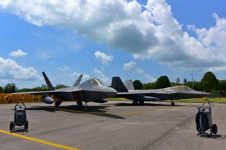 lockheed martin: SINGAPORE - FEBRUARY 16:  USAF Lockheed Martin F-22 Raptor on display at Singapore Airshow February 16, 2016 in Singapore
