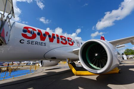 bombardier: SINGAPORE - FEBRUARY 16:  Swiss International Air Lines new Bombardier CSeries passenger jet on display at Singapore Airshow February 16, 2016 in Singapore