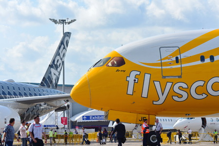 rival: SINGAPORE - FEBRUARY 16:  Scoot Boeing 787 Dreamliner parked next to rival Airbus A350-900 XWB at Singapore Airshow February 16, 2016 in Singapore Editorial