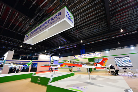 twin engine: SINGAPORE - FEBRUARY 16:  Comac ARJ21 twin engine regional jet model on display at Singapore Airshow February 16, 2016 in Singapore Editorial