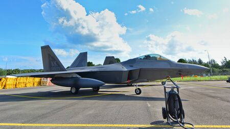 usaf: SINGAPORE - FEBRUARY 16:  USAF Lockheed Martin F22 Raptor on display at Singapore Airshow February 16, 2016 in Singapore Editorial