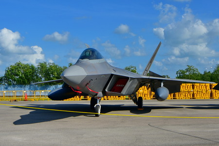 lockheed martin: SINGAPORE - FEBRUARY 16:  USAF Lockheed Martin F22 Raptor on display at Singapore Airshow February 16, 2016 in Singapore Editorial