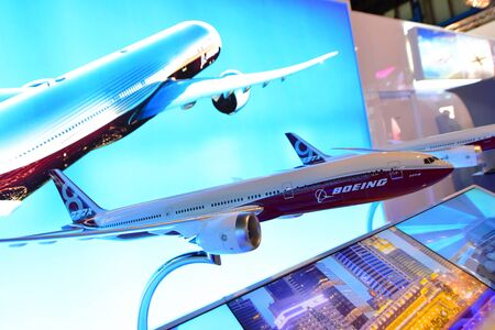 long range: SINGAPORE - FEBRUARY 16:  Models of Boeing 777x new long range aircraft on display at Singapore Airshow February 16, 2016 in Singapore