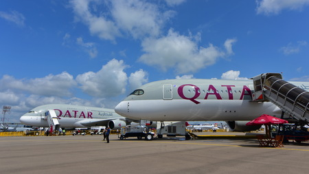 airways: SINGAPORE - FEBRUARY 16:  Qatar Airways Airbus A380 and A350-900 XWB on display at Singapore Airshow February 16, 2016 in Singapore Editorial