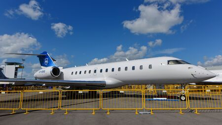 bombardier: SINGAPORE - FEBRUARY 16:  Bombardier Global 5000 business jet on display at Singapore Airshow February 16, 2016 in Singapore Editorial
