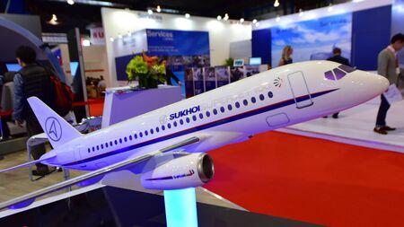 twin engine: SINGAPORE - FEBRUARY 16: Sukhoi Superjet 100 twin engine regional jet on display at Singapore Airshow February 16, 2016 in Singapore