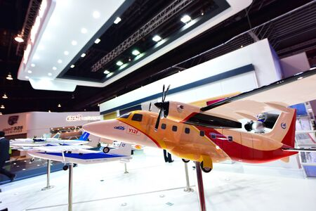 twin engine: SINGAPORE - FEBRUARY 16: Model of Chinese Civil Aicraft Y12F twin engine turboprop passenger aircraft on display at Singapore Airshow February 16, 2016 in Singapore