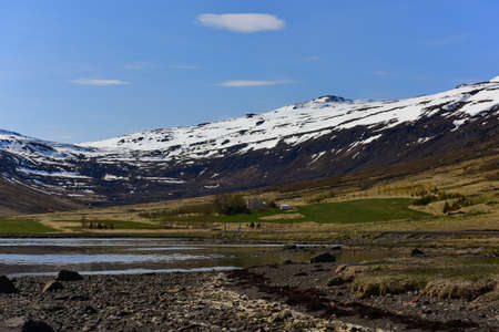 snow covered mountain: Mjoifjordur fjord with snow covered mountain in east Iceland Stock Photo