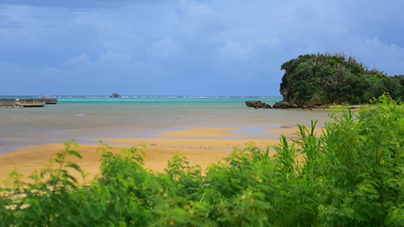 Sea glass beach in Okinawa, Japan, famous for its colorful glass bits in the sand Stock Photo