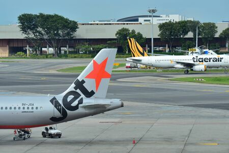 rival: SINGAPORE - DECEMBER 23: Rival low cost carriers Jetstar Asia and Tigerair at Changi Airport on December 23, 2016 in Singapore Editorial