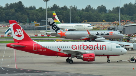 SINGAPORE - DECEMBER 23: Air Berlin Airbus A320 pushing back for departure at Changi Airport on December 23, 2016 in Singapore