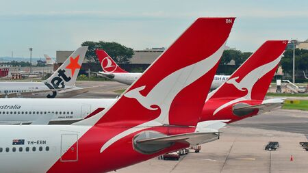 SINGAPORE - DECEMBER 23: Tails of Jetstar International, Qantas and Turkish Airlines aircraft at Changi Airport on December 23, 2016 in Singapore