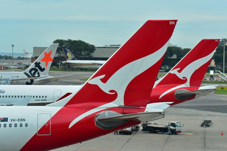 SINGAPORE - DECEMBER 23: Tails of Singapore Airlines, Jetstar International and Qantas aircraft at Changi Airport on December 23, 2016 in Singapore