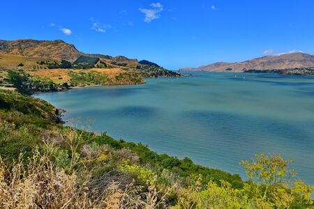 Scenic landscape of the sea and hills at Diamond Harbour in Canterbury, New Zealand