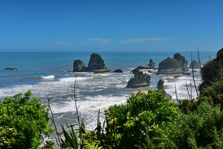 Rock formations and scenic landscape at Motukiekie Beach in West Coast, New Zealand Stock Photo