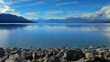 Lake Pukaki with Mount Cook and mountain ranges in the background, in Canterbury, New Zealand Stock Photo