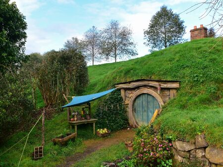 MATAMATA, NEW ZEALAND - AUGUST 2017: A house in Hobbiton movie set featured in Lord of the Rings and Hobbit movies on August 27, 2017 in Matamata
