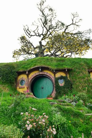 MATAMATA, NEW ZEALAND - AUGUST 2017: Bilbo Baggins home in Hobbiton movie set featured in Lord of the Rings and Hobbit movies on August 27, 2017 in Matamata