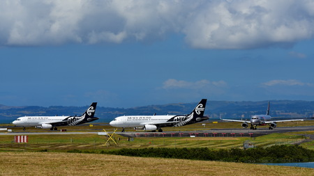 AUCKLAND, NEW ZEALAND - DECEMBER 17: Air New Zealand and rival Jetstar Airbus A320s taxiing at Auckland International Airport on December 17, 2017 in Auckland