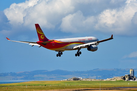 AUCKLAND, NEW ZEALAND - DECEMBER 17: Hainan Airlines Airbus A330 landing at Auckland International Airport on December 17, 2017 in Auckland Editorial
