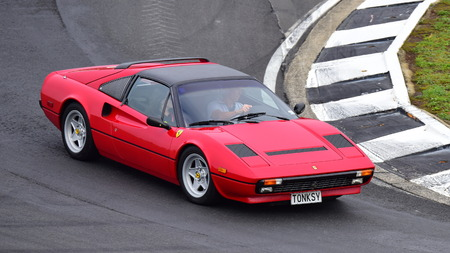 HAMPTON DOWNS, NEW ZEALAND - APRIL 18: 1983 Ferrari 308 driving around the circuit at Ferrari Challenge Asia Pacific Series race on April 15, 2018 in Hampton Downs Editorial