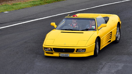 HAMPTON DOWNS, NEW ZEALAND - APRIL 18:1993 Ferrari 348 SP driving around the circuit at Ferrari Challenge Asia Pacific Series race on April 15, 2018 in Hampton Downs