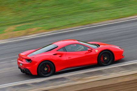 HAMPTON DOWNS, NEW ZEALAND - APRIL 18: Ferrari 488 GTB driving around circuit at Ferrari Challenge Asia Pacific Series race on April 15, 2018 in Hampton Downs Editorial