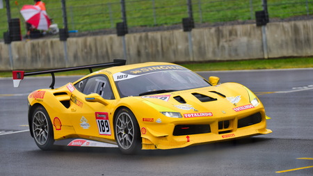 HAMPTON DOWNS, NEW ZEALAND - APRIL 18: Rama Danindro racing in a Ferrari 488 Challenge at Ferrari Challenge Asia Pacific Series race on April 15, 2018 in Hampton Downs Editorial