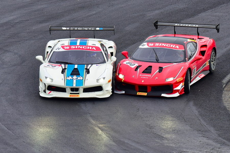 HAMPTON DOWNS, NEW ZEALAND - APRIL 18: Go Max & Alex Au racing each other at Ferrari Challenge Asia Pacific Series race on April 15, 2018 in Hampton Downs Editorial