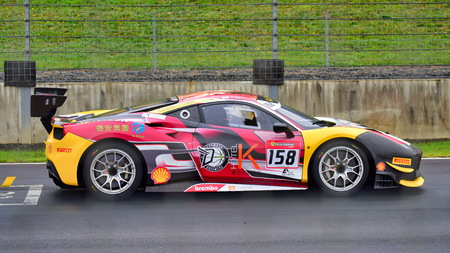 HAMPTON DOWNS, NEW ZEALAND - APRIL 18: Kent Chen racing at Ferrari Challenge Asia Pacific Series race on April 15, 2018 in Hampton Downs Editorial